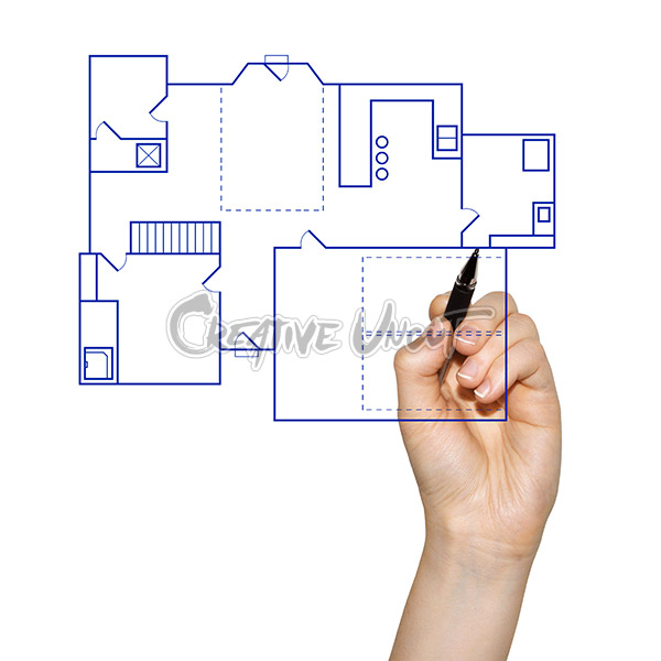 woman s hand drawing a blueprint for the construction of a house